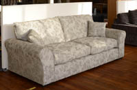 Beige fabric modern 3 seater sofa at sale price by cavendish